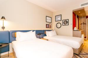 A bed or beds in a room at Hampton By Hilton Blackburn
