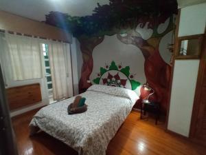 A bed or beds in a room at La Casa Verde