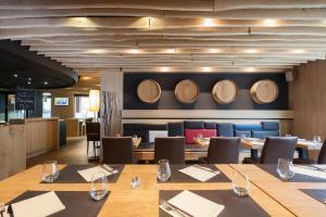 Restaurant ou autre lieu de restauration dans l'établissement Ibis Aéroport Bâle Mulhouse