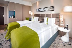 A bed or beds in a room at Holiday Inn Berlin City East Side, an IHG Hotel