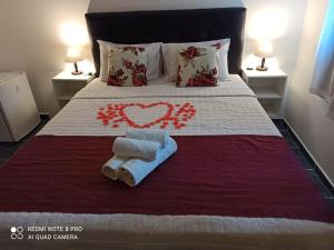 A bed or beds in a room at Pousada Elegance Beira Mar