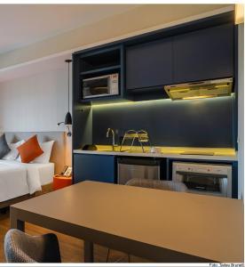 A kitchen or kitchenette at Aparthotel Adagio Sao Paulo Barra Funda