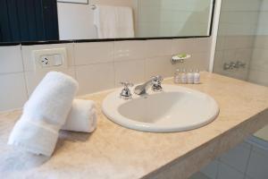 A bathroom at Postales Green Aparts - Chacras de Coria