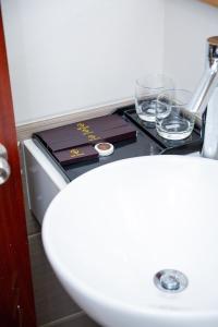 A bathroom at Silk Hotel near Tan Son Nhat Airport
