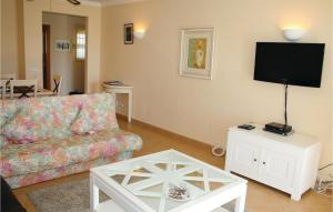 A television and/or entertainment center at Two-Bedroom Apartment in Alvor
