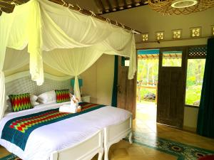 A bed or beds in a room at Darmada Eco Resort
