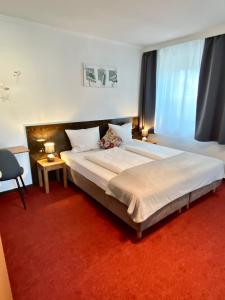 Ein Bett oder Betten in einem Zimmer der Unterkunft Bed & Rooms, Wörgl