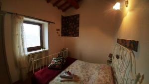 Een bed of bedden in een kamer bij il nostro sogno