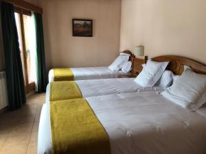 Cama o camas de una habitación en Hotel Soldeu Maistre