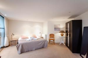 Ein Bett oder Betten in einem Zimmer der Unterkunft Villa Zuid