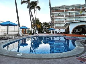 The swimming pool at or near Hotel Rosita