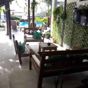 A restaurant or other place to eat at Pousada Vila do Sol