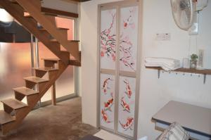 A kitchen or kitchenette at Dou Houz Guest House