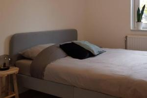 A bed or beds in a room at Luxurious house @ Beautiful Maastricht near centre