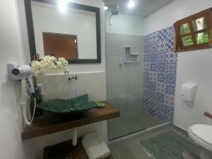 Um banheiro em Pousada Varanda dos Reis Suítes