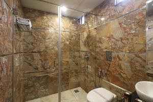 A bathroom at Hotel Mannat international by Mannat