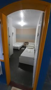 A bed or beds in a room at Suítes Ilha Grande