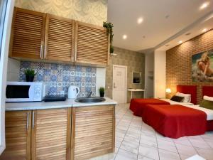 A kitchen or kitchenette at CityComfort Hotel Kitay- Gorod