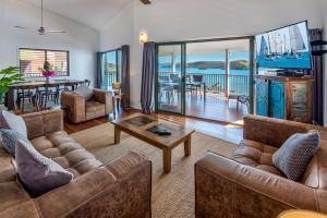A seating area at Casuarina Cove 13 on Hamilton Island by HamoRent