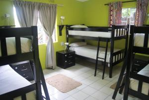 A bunk bed or bunk beds in a room at Lebo's Soweto Backpackers