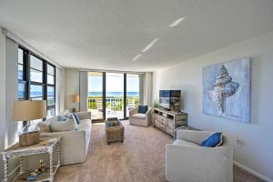 A seating area at Resort Condo with Balcony and Stunning Ocean Views!