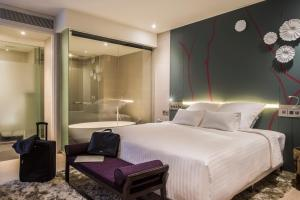 A bed or beds in a room at Pullman Saigon Centre