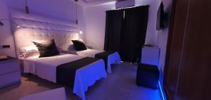 Letto o letti in una camera di Hotel Vedra