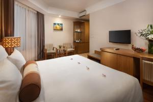 A bed or beds in a room at Diamond Sea Hotel