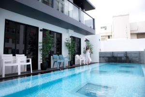The swimming pool at or near Hotel NuVe Urbane (SG Clean, Staycation Approved)