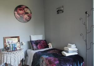 A bed or beds in a room at SOLVE Sanctuary