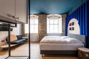Кровать или кровати в номере Romantik Hotel Zur Schwane