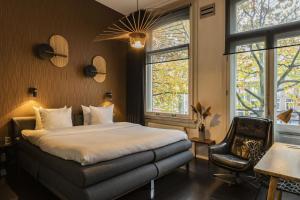 Ein Bett oder Betten in einem Zimmer der Unterkunft Hotel V Frederiksplein