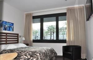 A bed or beds in a room at La Ciudadela