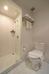 A bathroom at Grand Zuri Cikarang Jababeka