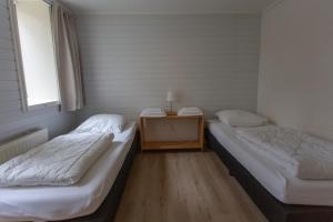Een bed of bedden in een kamer bij Folkshegeskoalle Schylgeralân