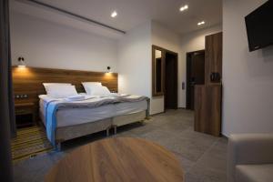 """Кровать или кровати в номере Лесной отель """"Рантала"""""""