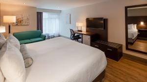 Кровать или кровати в номере Best Western Hotel St. Jerome