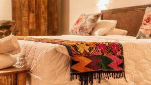 A bed or beds in a room at Le Village Boutique Hotel