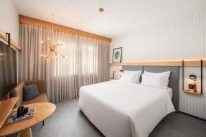 Cama ou camas em um quarto em Intercity Porto Alegre Aeroporto