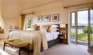 A bed or beds in a room at Sheen Falls Lodge