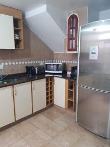 A kitchen or kitchenette at Apartamento Tipo Casa