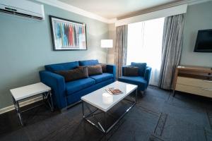Coin salon dans l'établissement Alexis Park All Suite Resort