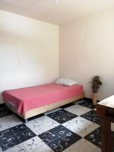 A bed or beds in a room at Tu Casa Natura