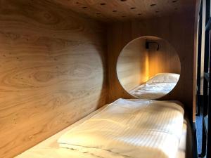 Ein Bett oder Betten in einem Zimmer der Unterkunft Vakantiedomein Hoge Duin