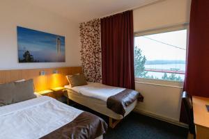 Säng eller sängar i ett rum på Hotell Höga Kusten