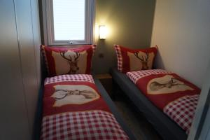 A bed or beds in a room at Mobilheim O'Hara