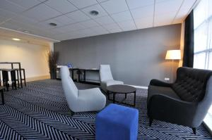 A seating area at Holiday Inn Express Leigh - Sports Village, an IHG Hotel