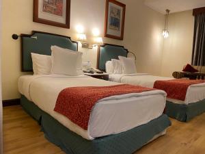 Кровать или кровати в номере Welcomhotel by ITC Hotels, Cathedral Road, Chennai