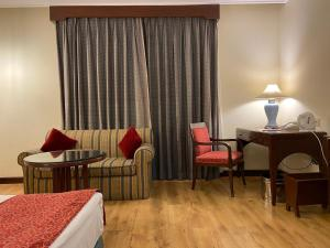 Гостиная зона в Welcomhotel by ITC Hotels, Cathedral Road, Chennai