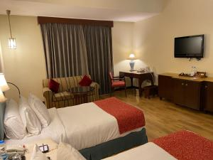 Телевизор и/или развлекательный центр в Welcomhotel by ITC Hotels, Cathedral Road, Chennai